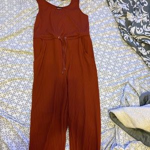 A burnt orange jumper that goes to ankles